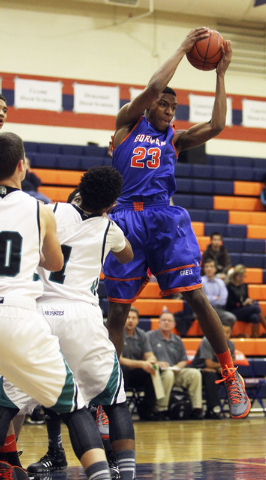 Gorman's Nick Blair (23) grabs a rebound against Sheldon's Matt Manning, left, and Elishja Duplechan (1) during their game in the Tarkanian Classic at Bishop Gorman High School in Las Vegas, Thurs ...