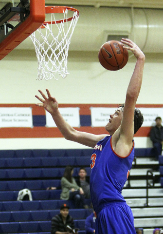 Gorman's Stephen Zimmerman goes to the basket against Sheldon during their game in the Tarkanian Classic at Bishop Gorman High School in Las Vegas, Thursday, Dec. 19, 2013. (Jerry Henkel/Las Vegas ...