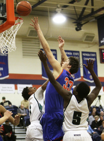 Gorman's Stephen Zimmerman tries for a basket while being double-teamed by Sheldon's Elishja Duplechan (1) and L.J. Williams (5) during their game in the Tarkanian Classic at Bishop Gorman High Sc ...