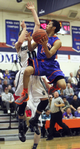 Gorman's Noah Robotham (14) goes up for a basket while being guarded by Sheldon's Matt Manning (10) during their game in the Tarkanian Classic at Bishop Gorman High School in Las Vegas, Thursday,  ...