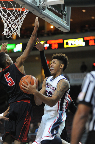 Findlay Prep basketball player Kelly Oubre Jr. goes in for a layup against the Prime Prep Academy defense during the Tarkanian Classic held at the Orleans Arena in Las Vegas Friday, Dec. 20, 2013. ...
