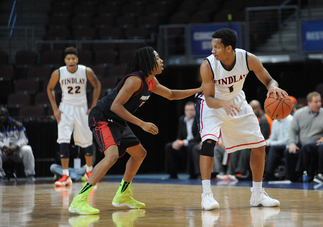 Findlay Prep basketball player Rashad Vaughn, right, dribbles the ball over Prime Prep Academy De-Shawn Williams, during the Tarkanian Classic held at the Orleans Arena in Las Vegas Friday, Dec. 2 ...