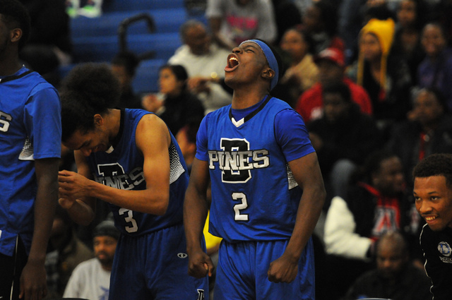 Desert Pines Tim Hough (2) and Kevin Butler (3) react to a play from the sideline in their away game against Canyon Springs, Thursday, Dec. 5, 2013. Canyon Springs won the game 66-61 against the J ...
