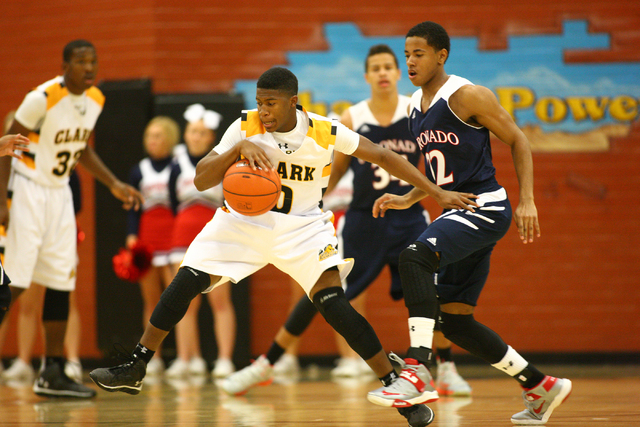 Clark's Colby Jackson (0) drives past Coronado's Eddie Austin (22) during a basketball game at Clark High School in Las Vegas on Monday, Dec. 2, 2013. (Chase Stevens/Las Vegas Review-Journal)