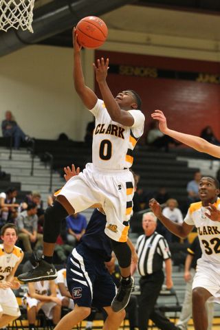 Clark's Colby Jackson (0) goes for a shot against Coronado during a basketball game at Clark High School in Las Vegas on Monday, Dec. 2, 2013. (Chase Stevens/Las Vegas Review-Journal)