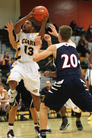 Clark's Ty'Rek Wells (13) looks to shoot over Coronado's Nick Korniek (20) during a basketball game at Clark High School in Las Vegas on Monday, Dec. 2, 2013. (Chase Stevens/Las Vegas Review-Journal)
