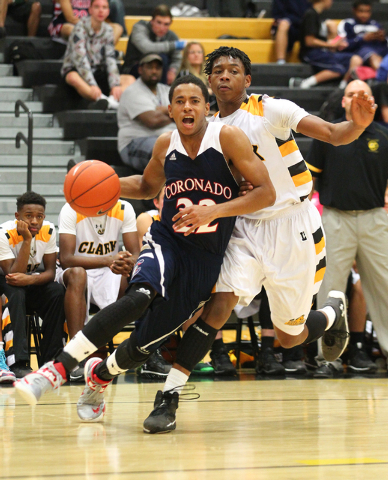 Coronado's Eddie Austin (22) looks to go for a shot as he gets past Clark's Darius Jackson (44) during a basketball game at Clark High School in Las Vegas on Monday, Dec. 2, 2013. (Chase Stevens/L ...