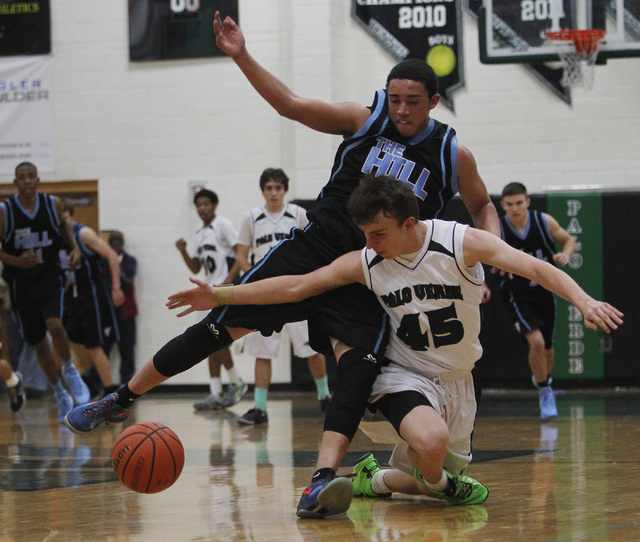 Palo Verde's Nick Cavaleri (45) battles Foothill's Austin Starr (30) for a loose ball during their basketball game in Summerlin on Dec. 3, 2013. (Jason Bean /Las Vegas Review-Journal)