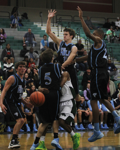 The Foothill defense surrounds Palo Verde's Braxton Richards (1) during their basketball game in Summerlin on Dec. 3, 2013. (Jason Bean /Las Vegas Review-Journal)