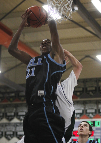 Foothill's Torrance Littles (21) grabs an offensive rebound over Palo Verde's Travis Gondrezick (24) during their basketball game in Summerlin on Dec. 3, 2013. (Jason Bean /Las Vegas Review-Journal)