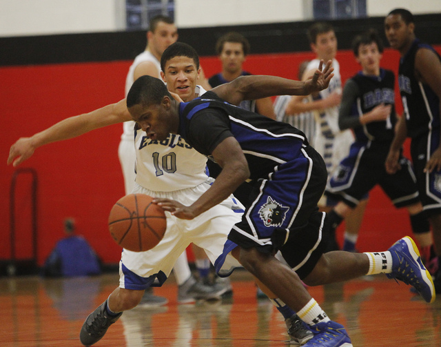 Basic's Antraye Johnson (2) steals the ball from Graves County's Andrew Smith (10) during the Las Vegas Prep Championship basketball tournament at Las Vegas High School on Thursday, Dec. 26, 2013. ...