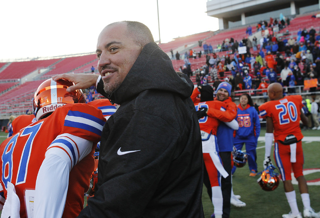 Bishop Gorman head coach Tony Sanchez congratulates his players after defeating Reed High School for the Division I Nevada State Football championship at Sam Boyd Stadium in Las Vegas on Dec. 7, 2 ...