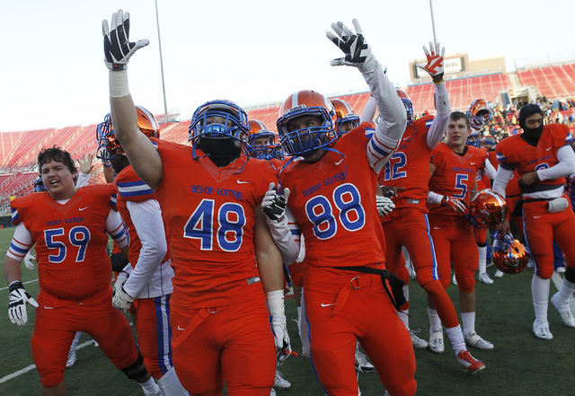 Bishop Gorman's Chris Lalli (48) and James Huber (88) celebrate their school's fifth consecutive Division I Nevada State Football championship at Sam Boyd Stadium in Las Vegas on Dec. 7, 2013. Bis ...