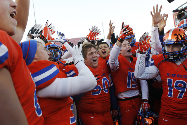 Bishop Gorman players celebrate their school's fifth consecutive Division I Nevada State Football championship at Sam Boyd Stadium in Las Vegas on Dec. 7, 2013. Bishop Gorman defeated Reed High Sc ...
