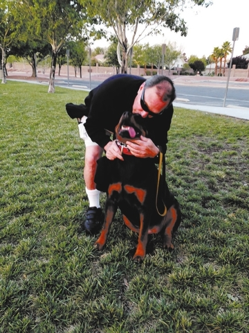 Claudia Albrecht's dog Bella sometimes walks with Gary Plaza in southwest Las Vegas.