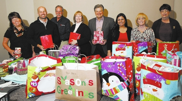 Courtesy photo  Pardee Homes employees wrap gifts for The Shade Tree Shelter and for Nevada Partnership for Homeless Youth. From left are Margy Litvin, Klif Andrews, Bill Bruce, Kathy Hilty, Rob T ...