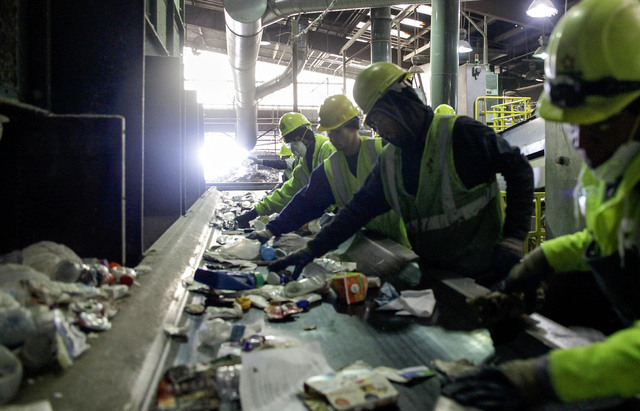 Sorters comb through recyclables at the Republic Services facility at 333 West Gowan Road in North Las Vegas Friday, Dec. 21, 2013. Republic Services is expanding their facilities to cope with inc ...