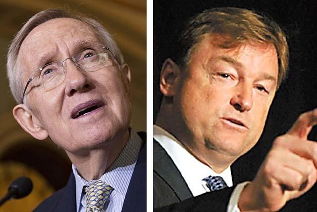 U.S. Sen. Majority Leader Harry Reid, D-Nev., left, and U.S. Sen. Dean Heller, R-Nev. (Associated Press)