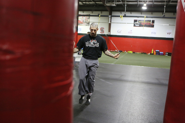 Adrian Bernard jumps rope during Steve Call's Relentless Youth Boxing Club workout at Phase 1 Sports gymnasium and training facility Saturday, Dec. 21, 2013, in Las Vegas. Call, who is a former dr ...