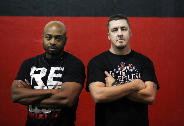 Nate Gould, left, co-owner of Phase 1 Sports, and Steve Call, founder of Relentless Youth Boxing Club, stand in the Phase 1 Sports gymnasium and training facility Saturday, Dec. 21, 2013, in Las V ...