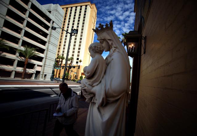 A man walks pass the Saint Joan of Arc Roman Catholic Church at 315 S. Casino Center Boulevard Friday Oct. 12, 2012. The parish was started in 1908. (File, Jeff Scheid/Las Vegas Review-Journal)