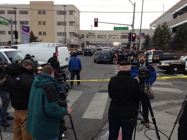 Reporters wait for updates at Renown Regional Medical Center in Reno. Police say a man shot four people, killing one of them, before killing himself on Tuesday. (@MattALush/Twitter)
