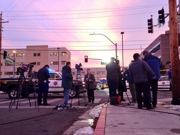 Reporters gather at the scene of the shooting at Renown Regional Medical Center in Reno. Police say a man shot four people, killing one of them, before killing himself on Tuesday. (@MattALush/Twitter)
