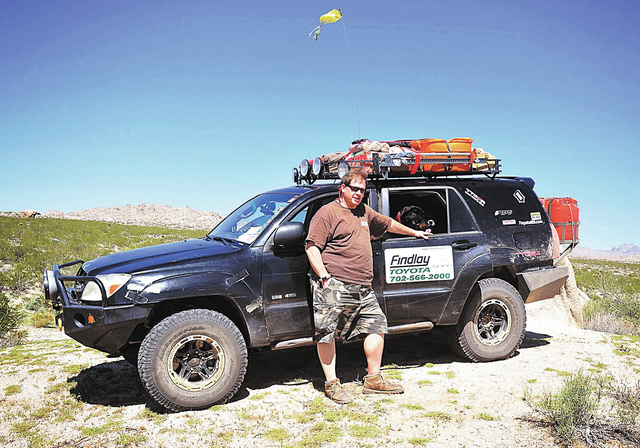 CAPTION: Findlay Toyota internet sales consultant Robert Anderson, shown with his  2003 Toyota 4Runner, is seen on his eighth annual Toyota 120 Mojave Road trip in the Mojave National Preserve las ...