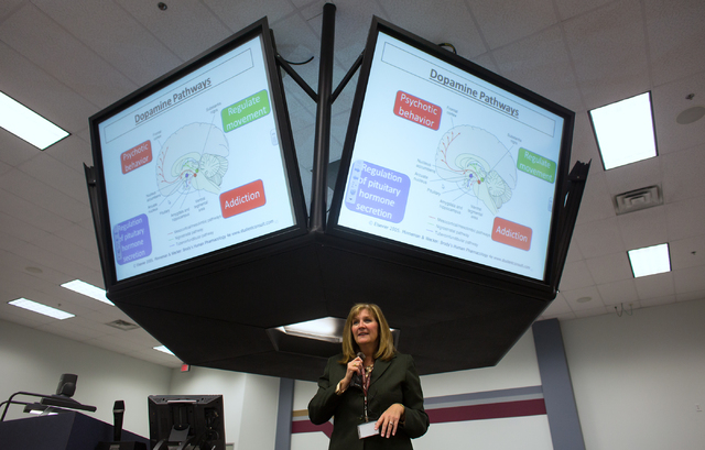 Renee Coffman, president of Roseman University of Health Sciences, talks to a neurological class on Nov. 20 at the Henderson campus. Roseman University is merging with Nevada Cancer Institute, whi ...