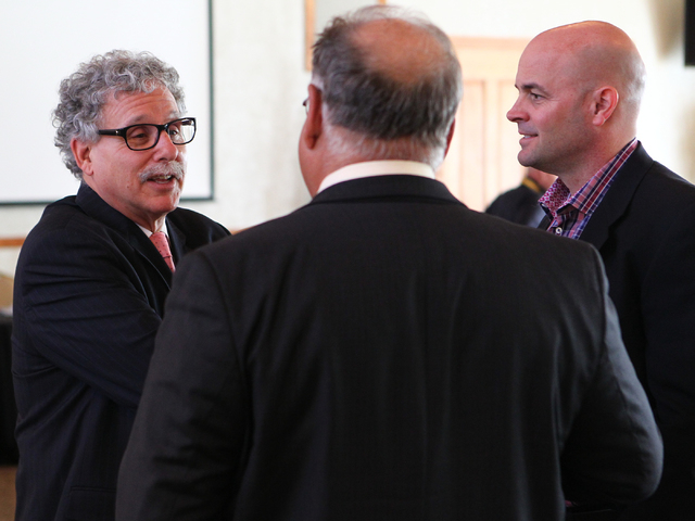 UNLV stadium consultant Mark Rosentraub, left, talks with Alan Petrasek, Senior VP of Clark Construction, center, and Erik Judson, Principal of JMI Sports, before the UNLV stadium board hearing at ...
