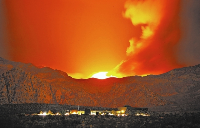 The Carpenter 1 Fire burns in the mountains behind the Red Rock Conservation Area visitor center near Las Vegas early in the morning of July 11. (John Locher/Las Vegas Review-Journal)