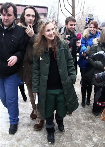 Maria Alekhina, center, a member of the Russian punk band Pussy Riot speaks to the media at the Committee against Torture after being released from prison, in Nizhny Novgorod, Russia on Monday, De ...