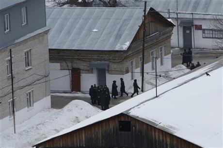 Prisoners walk inside the prison colony where jailed feminist punk band Pussy Riot member Maria Alekhina is held, outside Nizhny Novgorod, Russia, Friday, Dec. 20, 2013. The State Duma on Wednesda ...