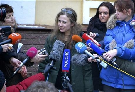 Maria Alekhina, second from left, a member of the Russian punk band Pussy Riot peaks to the media at the Committee against Torture after being released from prison, in Nizhny Novgorod, on Monday,  ...