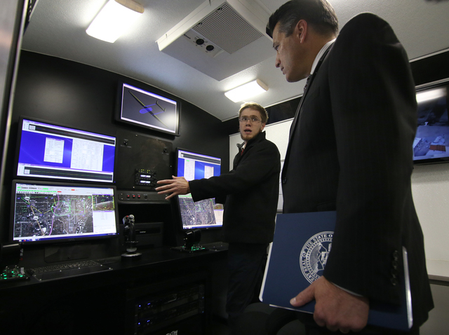 Drone America Engineer Russell Reinhart gives Nevada Gov. Brian Sandoval a tour of their operations trailer during  in Reno, Nev., on Thursday, Dec. 5, 2013. The tour was part of the statewide Cab ...