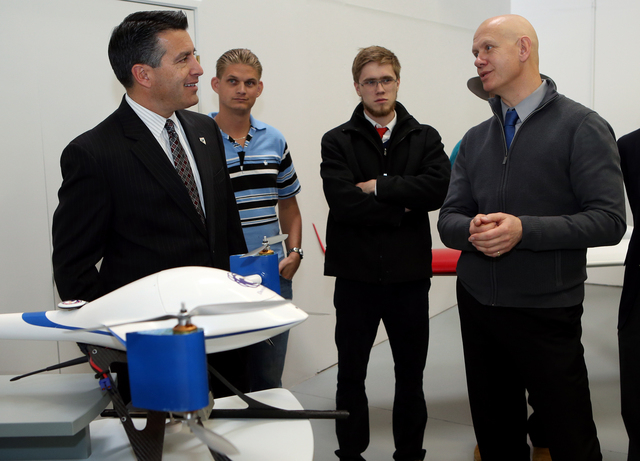 Drone America founder Mike Richards, right, talks with Nevada Gov. Brian Sandoval during a Cabinet Business Visit Day stop, in Reno, Nev., on Thursday, Dec. 5, 2013. (Cathleen Allison/Las Vegas Re ...