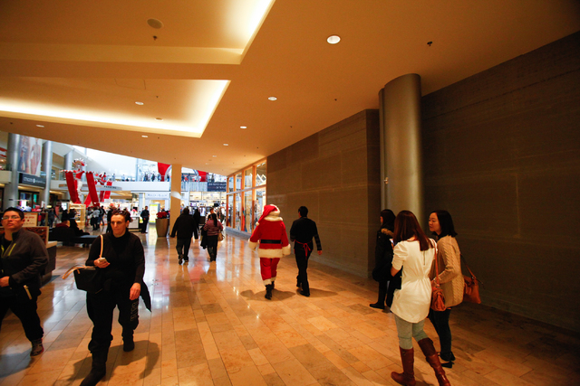 A man dressed as Santa Claus, who declined to give his name, goes to take his lunch break outside of Macy's at the Fashion Show Mall in Las Vegas on Dec. 7, 2013. (Chase Stevens/Las Vegas Review-J ...