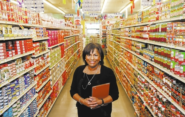 Ann Santiago, senior vice president of business development for TMC Financing, stands in an aisle at a La Bonita Supermarket in Las Vegas. TMC Financing is a local firm that helps Southern Nevada  ...