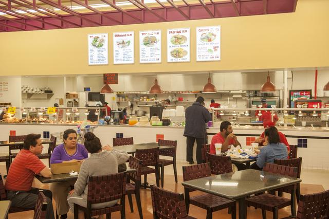 Customers enjoy a meal at La Bonita grocery store in Las Vegas on Monday, November 25, 2013. TMC Financing helped provide an SBA loan for La Bonita. (Jacob Kepler/Las Vegas Review-Journal)