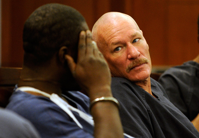 Richard Schlacta sits with other inmates before making his first appearance at the Regional Justice Center on Friday, August 30, 2013. (David Becker/Las Vegas Review-Journal)