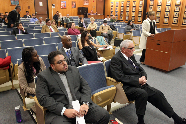 Marlene Monteolivo, at podium, speaks in support of Stavan Corbett, lower left, for Clark County School Board District D trustee during a special board meeting at the Edward A. Greer Education Cen ...