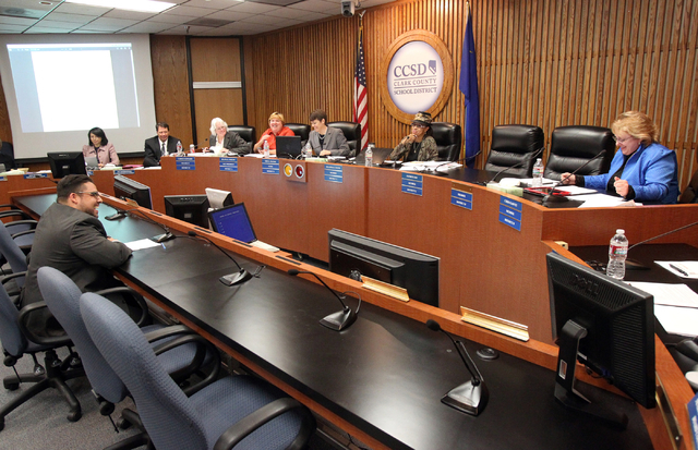 Clark County School Board District D trustee candidate Stavan Corbett, lower left, answers questions during a special board meeting to fill the vacant seat at the Edward A. Greer Education Center  ...
