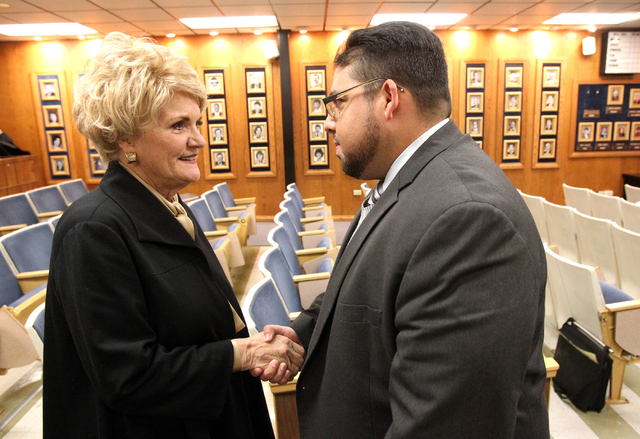 Stavan Corbett, right, is congratulated by former Nevada first lady Sandy Miller after he was named Clark County School Board District D trustee during a special board meeting at the Edward A. Gre ...