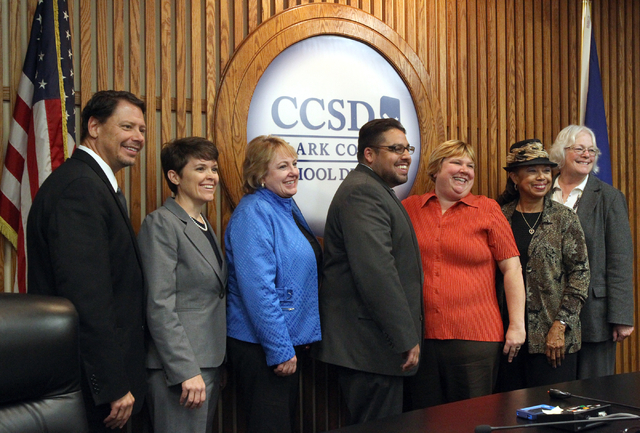 Stavan Corbett, center, poses for a photo with, from left, Superintendent Pat Skorkowsky, Erin E. Cranor, Chris Garvey, Deanna L. Wright, Dr. Linda E. Young and President Carolyn Edwards after he  ...
