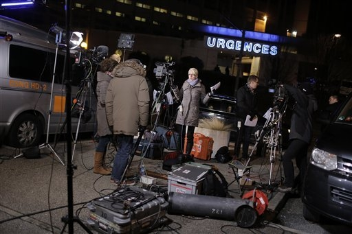 Journalists from a German TV channel broadcast  outside the entrance of the Grenoble hospital where former seven-time Formula One champion Michael Schumacher is being treated after sustaining a he ...