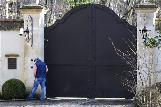 """An unidentified person stands at the entrance of the property """"La Reserve"""" occupied by German-born Formula One car driver Michael Schumacher, in Gland, on the shores of Lake Geneva, Swit ..."""