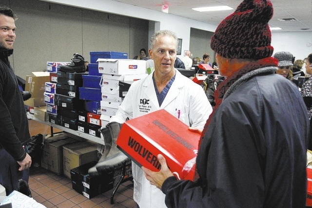 Dr. Troy Watson helps hand out shoes at the Salvation Army Friday, Nov. 22, 2013.  (John Locher/Las Vegas Review-Journal)