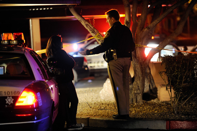 Las Vegas police investigate a shooting scene at the Regency Apartments at 3650 E. Lake Mead Blvd. on Tuesday. (David Becker/Las Vegas Review-Journal)