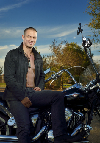 """Aidan Te Puke of """"Thunder from Down Under"""" at the Excalibur hotel-casino poses at Desert Bloom Park at 8405 S. Maryland Parkway in Las Vegas on Friday, Nov. 29, 2013. (Bill Hughes/Las Ve ..."""