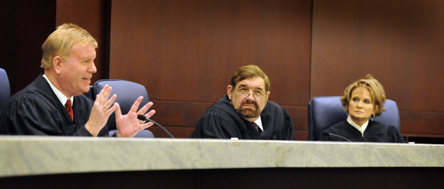 Nevada Supreme Court Justices, from left, Mark Gibbons, Michael Cherry and Nancy Saitta listen at the Regional Justice Center on Monday, August 3, 2009, as attorneys for O.J. Simpson and Clarence  ...